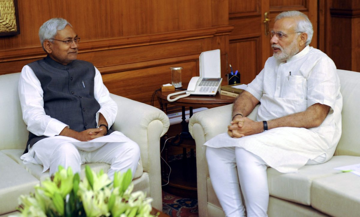 Prime Minister Narendra Modi (R) speaks with Nitish Kumar, the Chief Minister of the eastern state of Bihar, during a meeting in New Delhi. Photo: AFP
