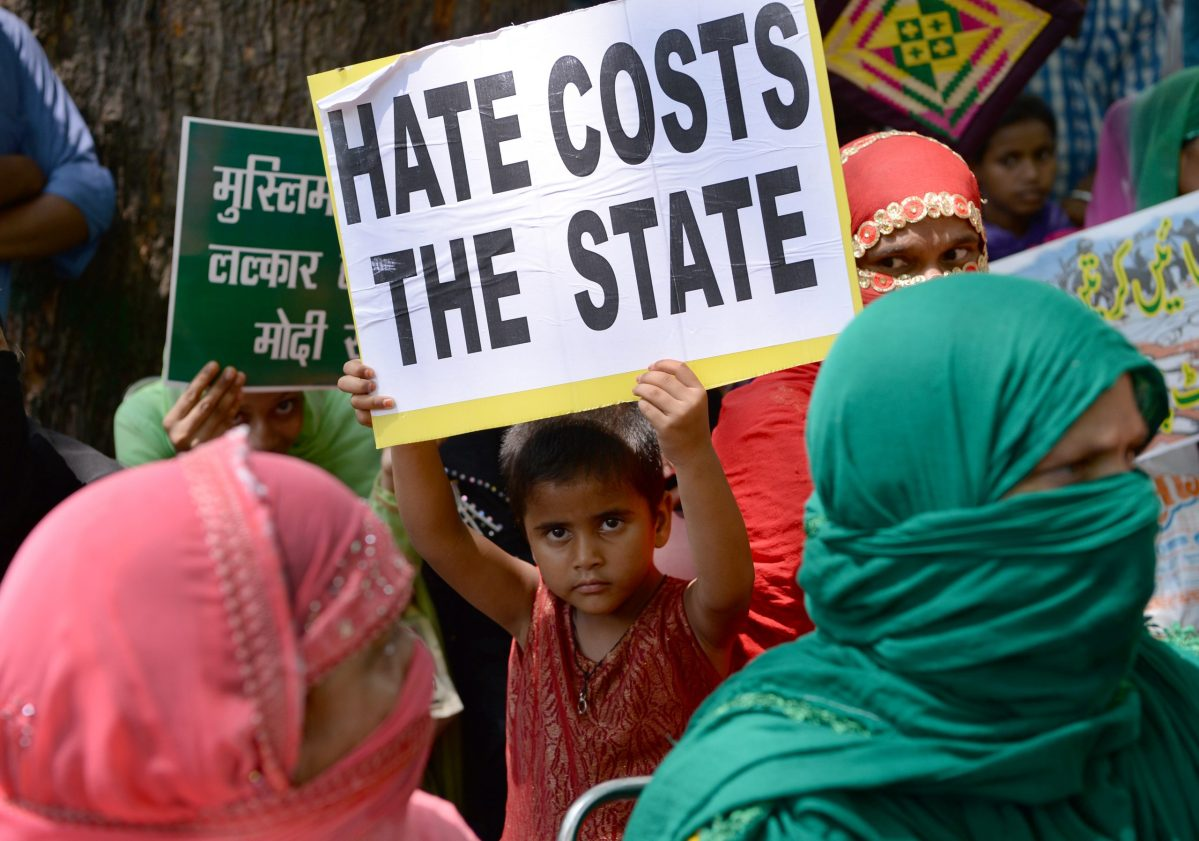 A young Indian demonstrator holds a placard at a rally in New Delhi, in protest over a spate of assaults against Muslims and low-caste Dalits by Hindu vigilantes in India. Photo: AFP