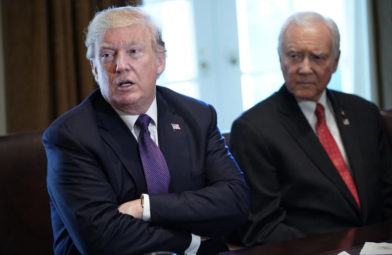 US President Donald Trump speaks next to Senate Finance Committee Chairman Orin Hatch. Photo: AFP