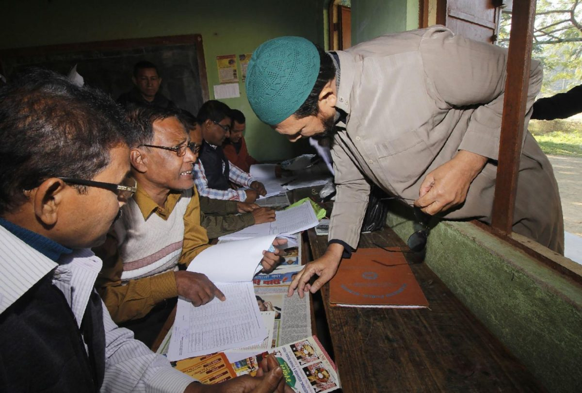 A man looks for his name on the first draft of the National Register of Citizens in Guwahati in the Indian state of Assam on January 1, 2018. Around 13 million people in Assam woke up to uncertainty on that day after the release of an official registry with names of only 19m of the state's over 32 million residents. Photo: AFP