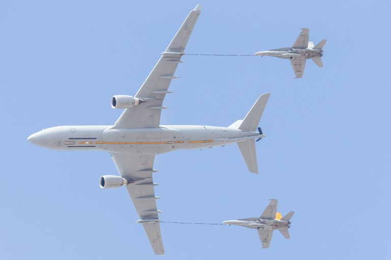 A Royal Australian Air Force P-8A Poseidon refuels two F/A -18F Super Hornet jets. Photo: Anadolu Agency via AFP