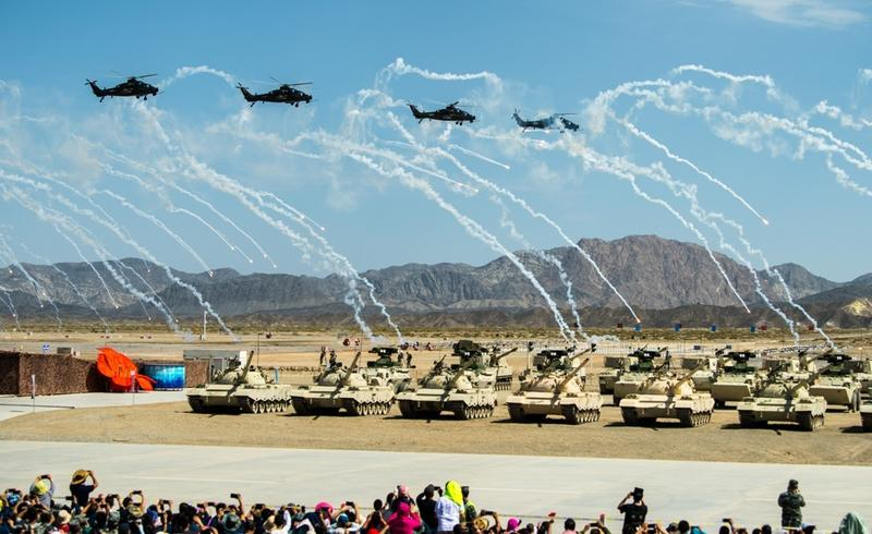 Helicopters from four armed forces hover above a viewing platform during the opening ceremony of the International Army Games in Korla on northwest China's Xinjiang Uyghur autonomous region on July 29, 2018. Photo: Xinhua