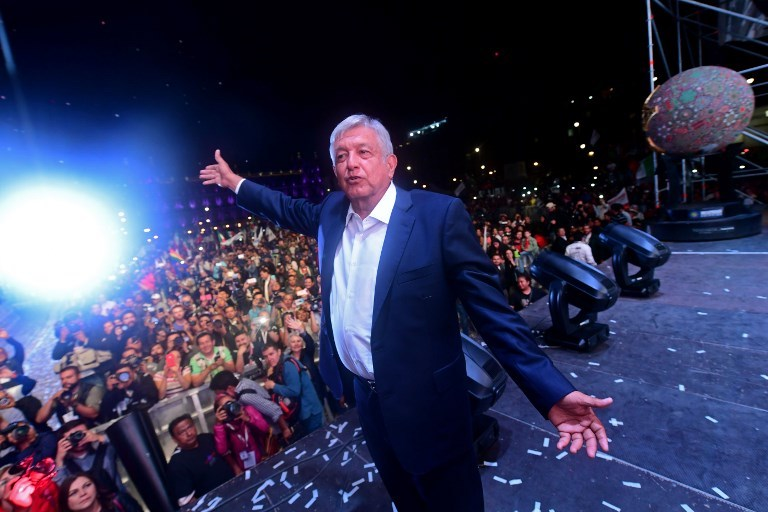 Andres Manuel Lopez Obrador cheers his supporters at Zocalo Square in Mexico City after winning the presidential election, on July 1, 2018. / Photo: AFP / Pedro Parido