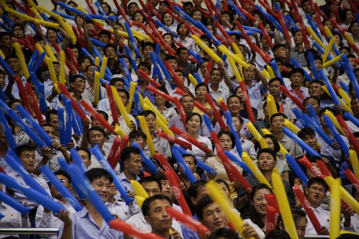 Fans cheer during a friendly basketball match between North and South Korea at the Ryugyong Jong Ju Yong Indoor Stadium in Pyongyang on July 4, 2018. Photo: AFP/Kim Won-Jin