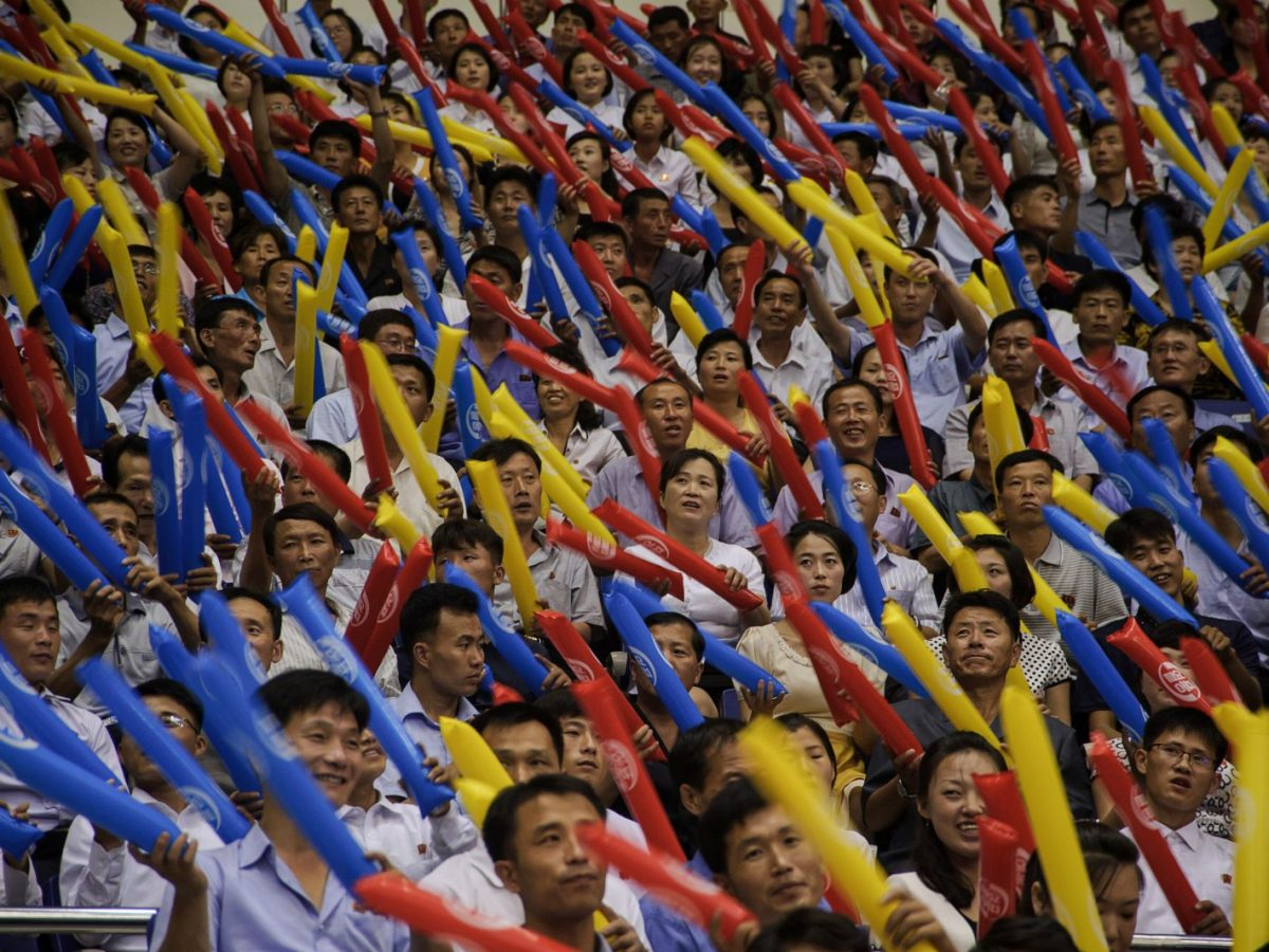 Fans cheer during a friendly basketball match between North and South Korea at the Ryugyong Jong Ju Yong Indoor Stadium in Pyongyang on July 4, 2018. Photo: AFP/Kim Won-Jin