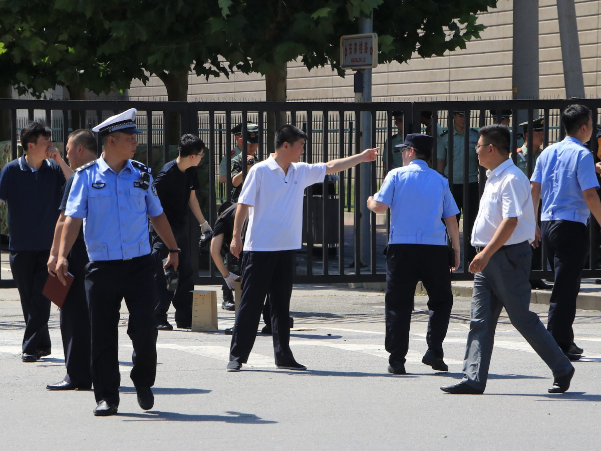 Security personnel and officials are seen  around the site of reported blast near the US embassy in Beijing on July 26, 2018. Photo: AFP / Yomiuri Shimbun