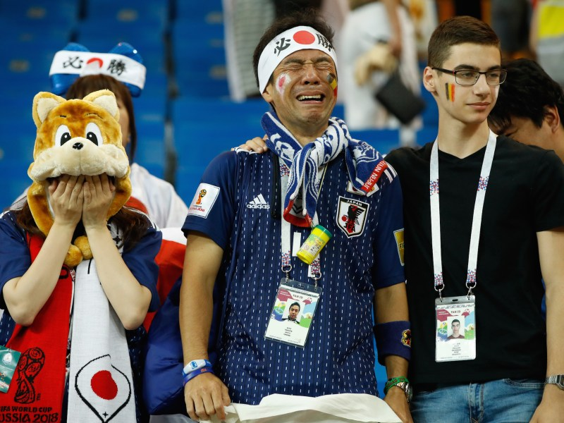 Two Japanese fans at the end of the Russia 2018 World Cup round of 16 match between Belgium and Japan. Belgium won 3-2 after scoring with the last kick of the game. Photo: AFP/Odd Andersen