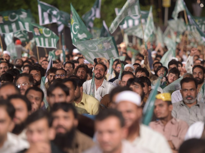 Supporters of the head of Pakistani militant organization Jamaat-ud-Dawa, Hafiz Saaed, look on and listen as they meet the members of the newly formed political party Allah-o-Akbar Tehreek, during a campaign meeting in Islamabad on July 21, 2018, ahead of the general election. Photo: AFP / Aamir Qureshi