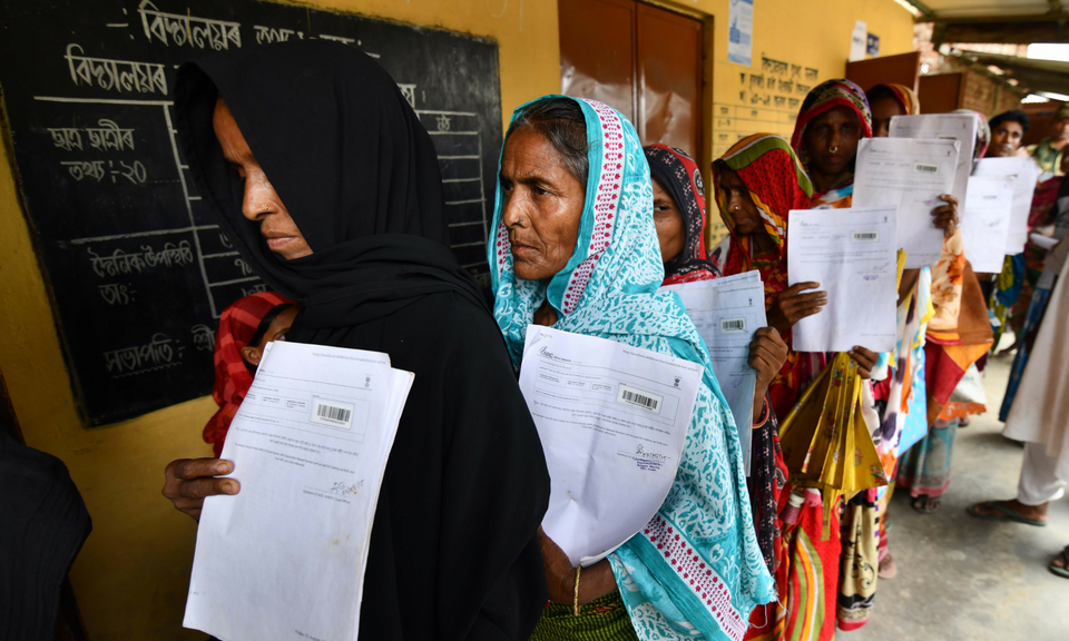 Residents hold their documents as they stand in a queue to check their names on the final list of National Register of Citizens (NRC) at a NRC Sewa Kendra (NSK) in Burgoan village in Morigoan district on July 30, 2018. India on July 30 stripped four million people of citizenship in the northeastern state of Assam, under a draft list that has sparked fears of deportation of largely Bengali-speaking Muslims. Photo: AFP