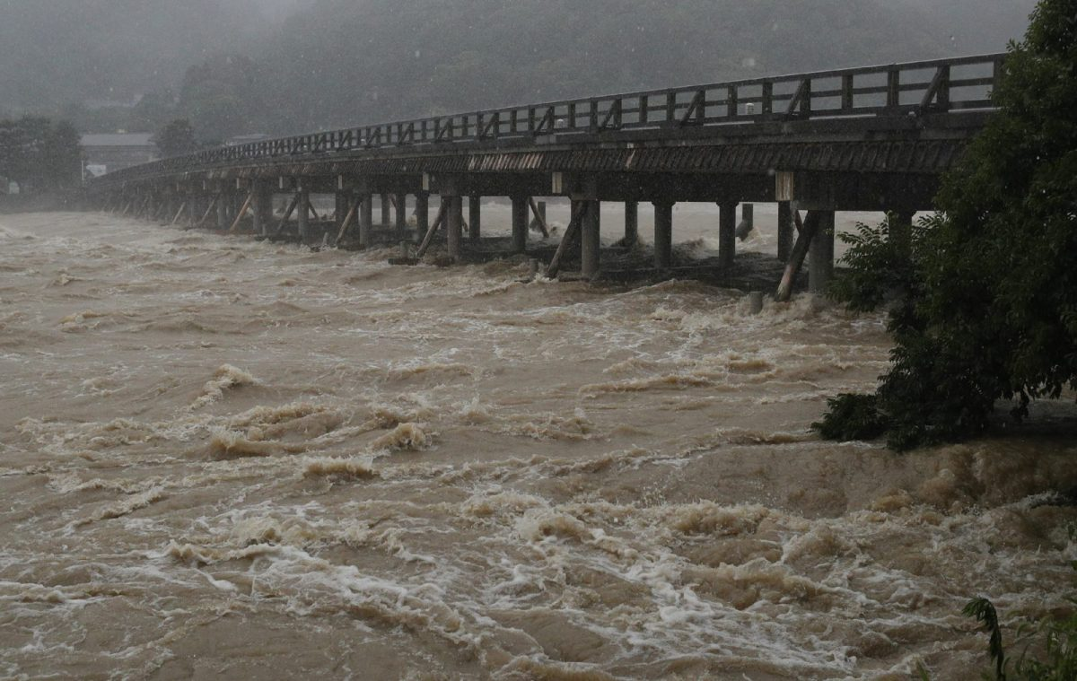 The Togetsu bridge on the Katsura river in Kyoto during heavy rains in western Japan on July 6, 2018. The country's meteorological agency has warned of more to come. Photo: AFP/JIJI PRESS