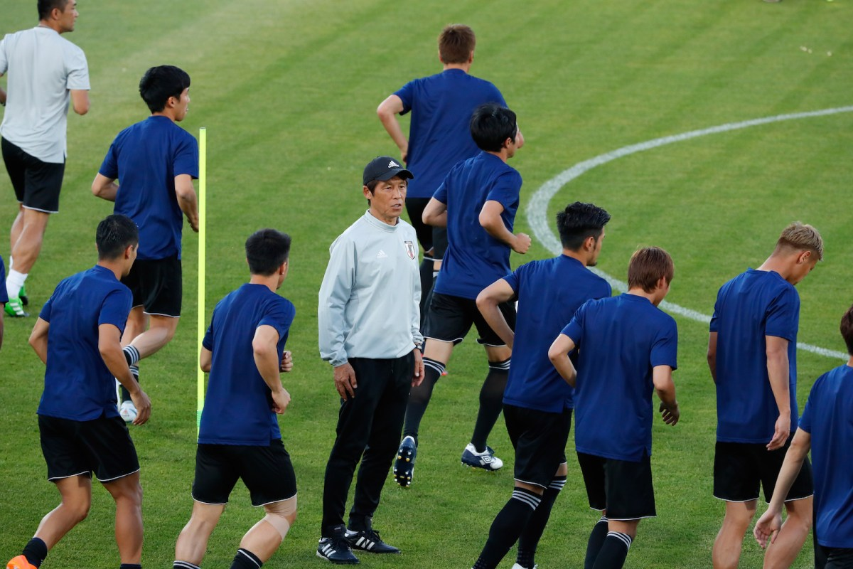Japan's coach Akira Nishino watches his players during a training session in Rostov-on-Don on Sunday July 1, on the eve of their Russia 2018 World Cup round of 16 football match against Belgium. Photo: AFP/ Jack Guez
