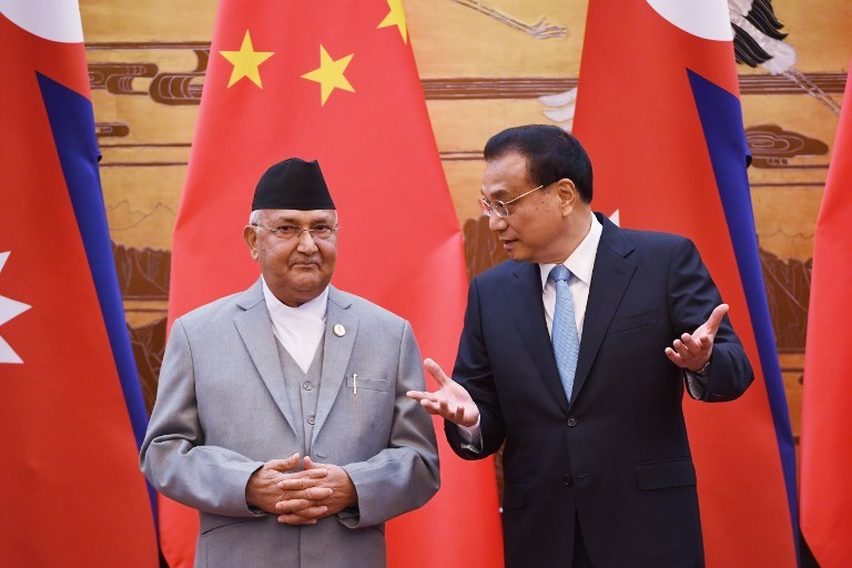 Nepalese Prime Minister K P Sharma Oli (left) chats with Chinese Premier Li Keqiang during a signing ceremony at the Great Hall of the People in Beijing on June 21, 2018. Photo: AFP  / Pool / Greg Baker