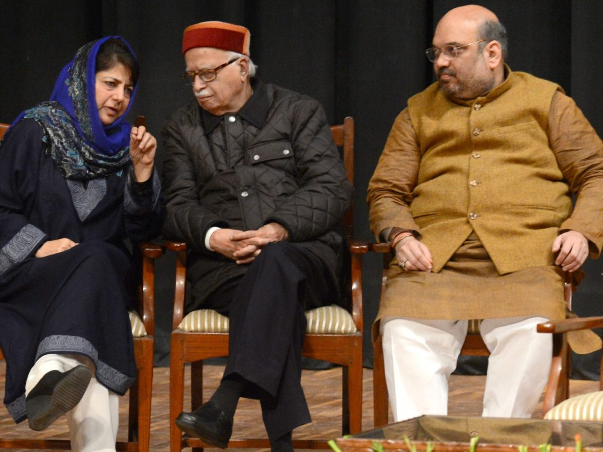 Peoples Democratic Party President Mehbooba Mufty (L), Bharatiya Janata Party senior leader Lal Krishna Advani and BJP President Amit Shah in the state assembly in Jammu on March 1, 2015. Photo: AFP/Tauseef Mustafa