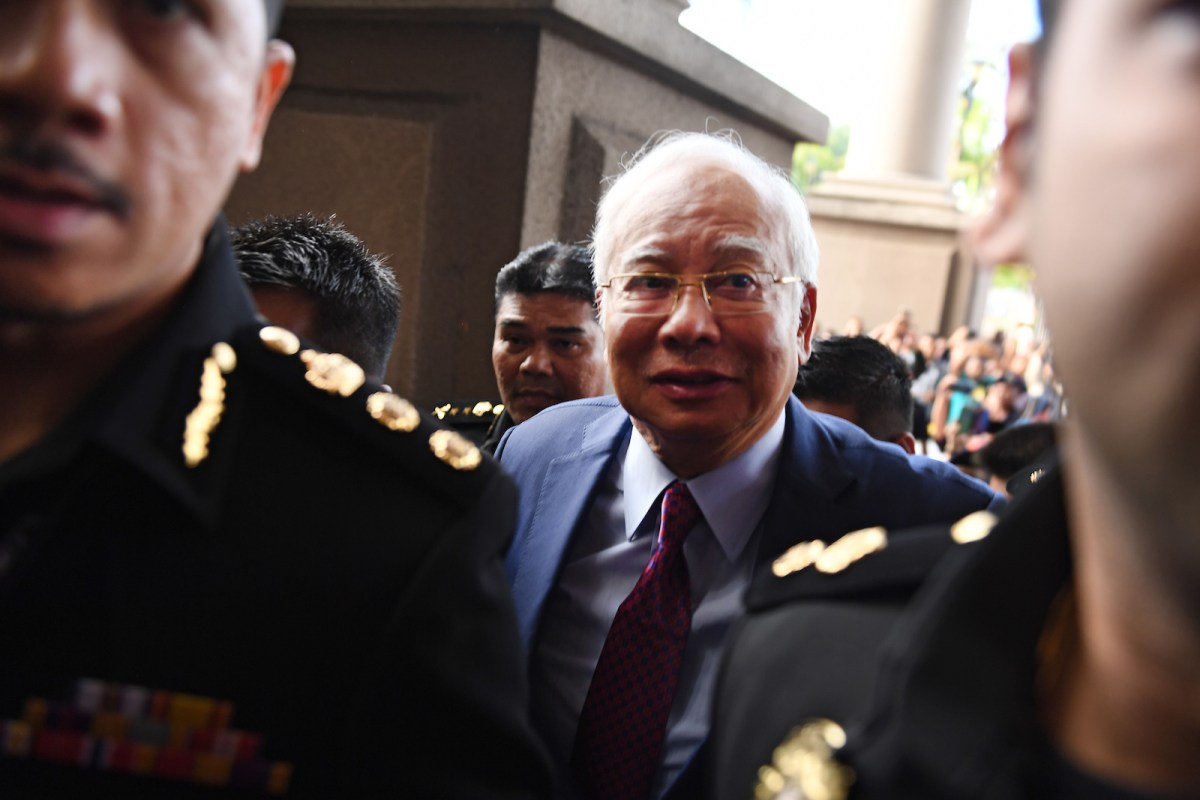 Former Malaysian prime minister Najib Razak (C) arrives for a court appearance at the Duta court complex in Kuala Lumpur on July 4, 2018.Najib, 64, was detained on July 3 as the government of Prime Minister Mahathir Mohamad intensified a probe on corruption during his rule, including the alleged siphoning off of billions of dollars from state fund 1MDB. Photo: AFP/Mohd Rasfan