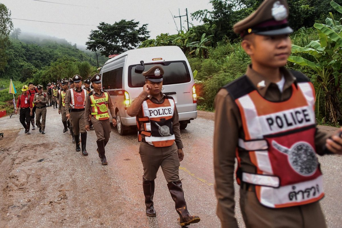 Thai police secure the road leading to Tham Luang cave as rescue operations continue for those still trapped inside the cave in Khun Nam Nang Non Forest Park in the Mae Sai district of Chiang Rai province on July 9, 2018. Photo: AFP/ Ye Aung Thu