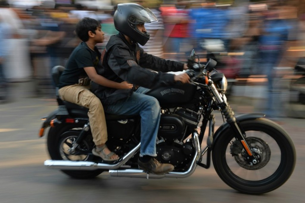 An Indian owner of a Harley Davidson motorcycle takes part in a bike rally on the streets of Bangalore: AFP
