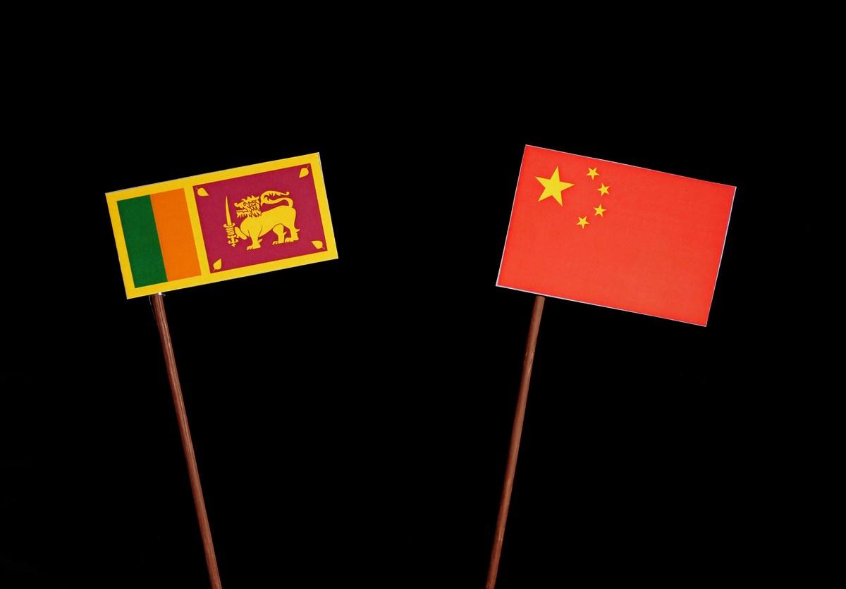 Sri Lanka flag with Chinese flag isolated on black background. Photo: iStock