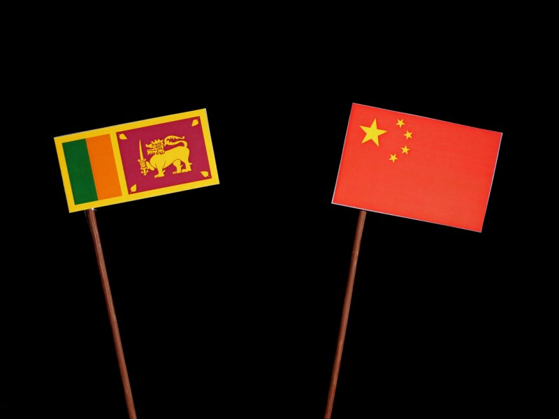 Sri Lanka flag with Chinese flag isolated on black background. Photo: iStock