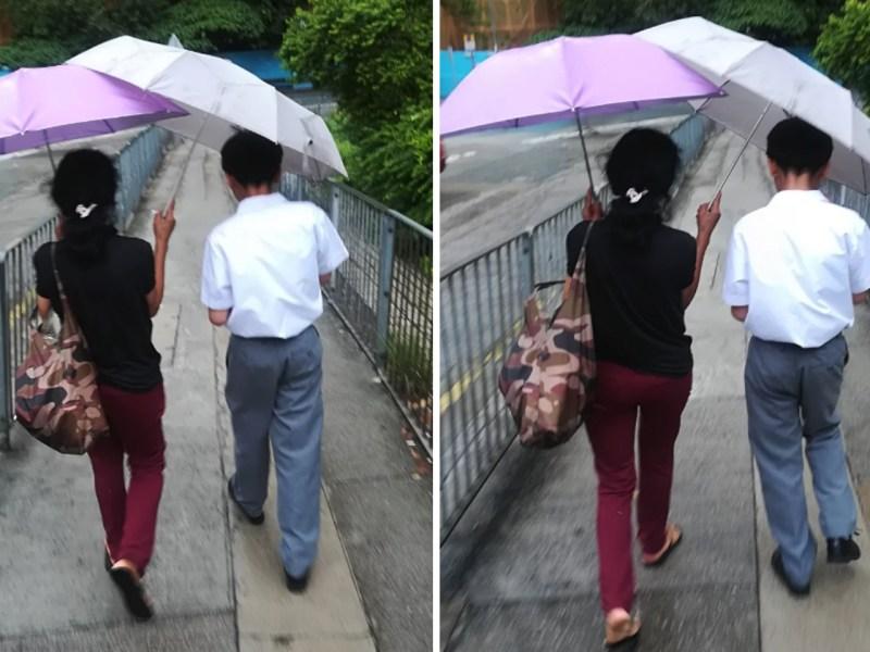 A domestic worker holds an umbrella for a boy. Photo: Hong Kong Discuss Forum