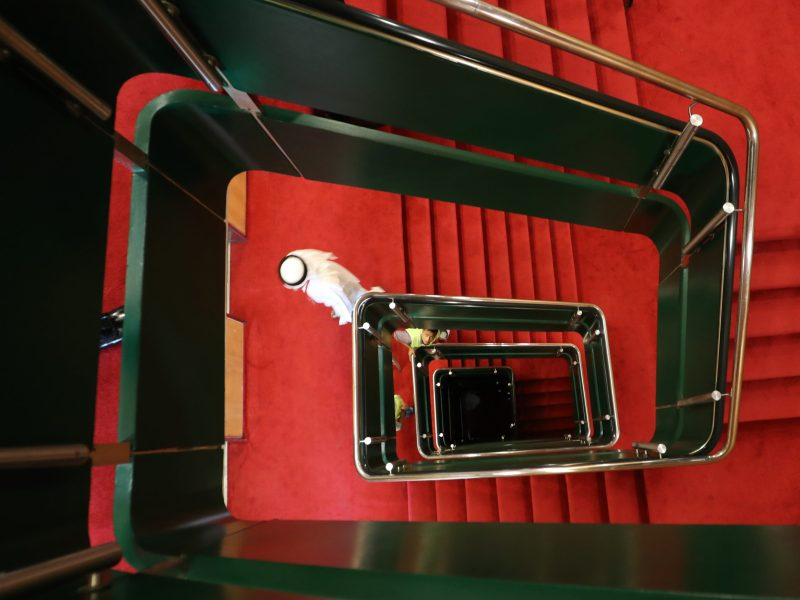 A lift system and stairwell allow guests to move between the 13 decks aboard The Queen Elizabeth II luxury cruise liner docked at Port Rashid in Dubai, where it will be moored permanently as a newly refurbished floating hotel on April 18, 2018. In Dubai, tourism is a major draw — yet over-supply in the hotels market, combined with a push for lower-spending mass tourism — has hit the profitability of tourism businesses. Photo: AFP / Karim Sahib
