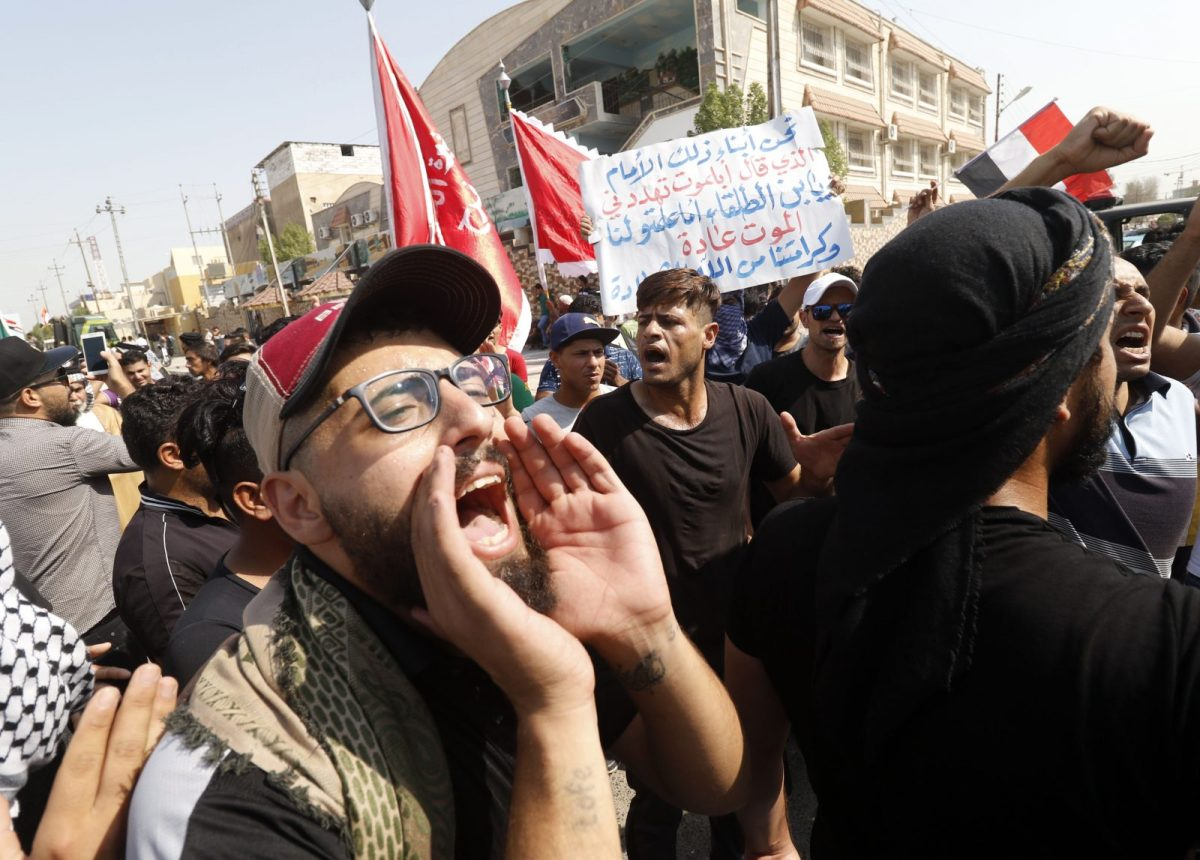 Iraqis shout slogans during ongoing protests in the southern city of Basra on August 5, 2018. Photo: AFP/Haidar Mohammed Ali