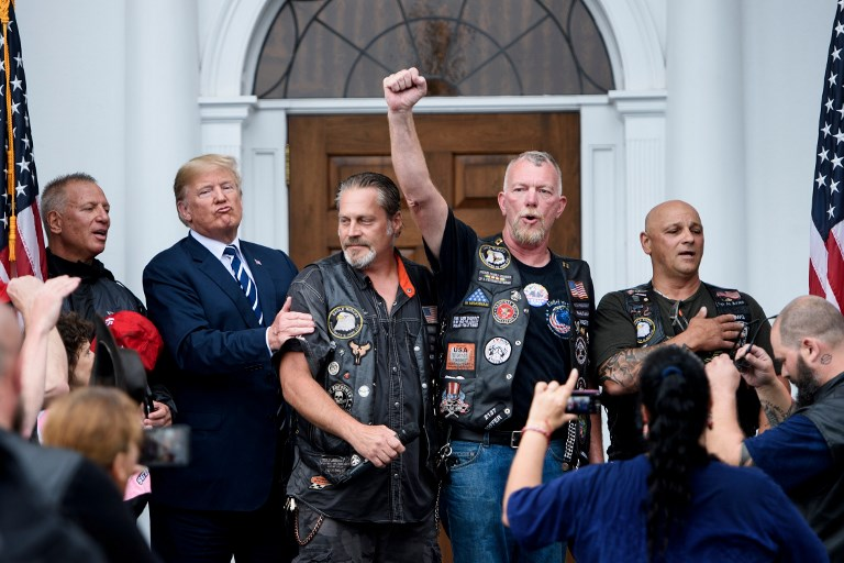US President Donald Trump listens as supporters cheer after the pledge of allegiance during a Bikers for Trump event at the Trump National Golf Club on August 11 in Bedminster, New Jersey. Photo: AFP