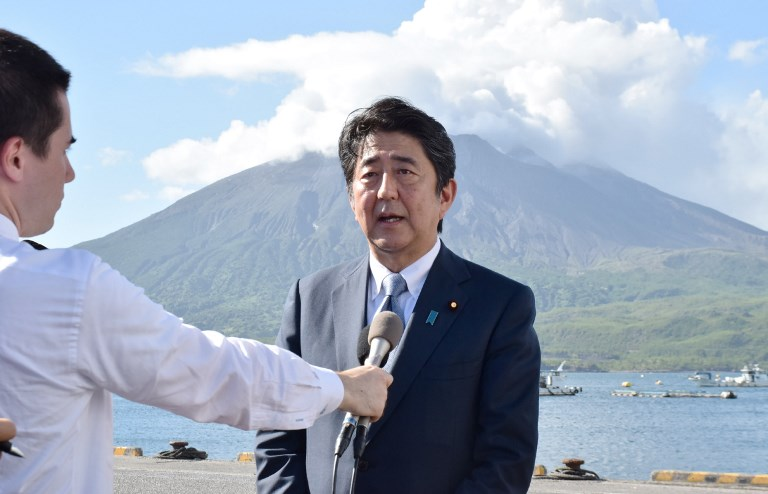 Japanese Prime Minister Shinzo Abe announces his candidacy for the upcoming ruling Liberal Democratic Party presidential election on August 26. Photo: AFP