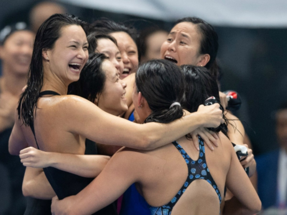 Hong Kong and Singaporean swimmers hug after the race. Photo: Sports Federation and Olympic Committee of Hong Kong, China