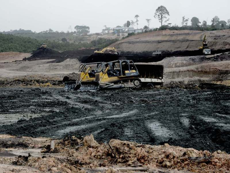 An open-pit coal mine in Jambi, south Sumatra.The Widodo government's preference for coal-power plants is an environmental and public health disaster, critics say. Photo: AFP / Goh Chai Hin