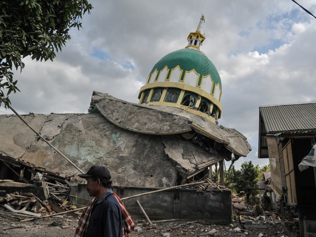 A mosque is damaged by the earthquake at Bayan on Lombok on August 11. Traditional homes survived the worst of the quake. Photo: AFP/ Anton Raharjo /NurPhoto