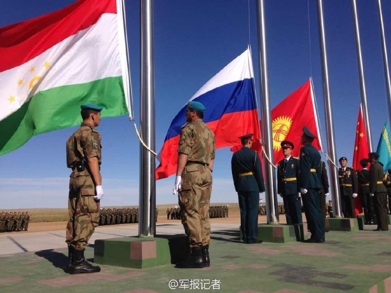 A 2014 file photo shows soldiers of SCO member countries raising their national flags prior to the start of an anti-terrorist exercise. Photo: Xinhua