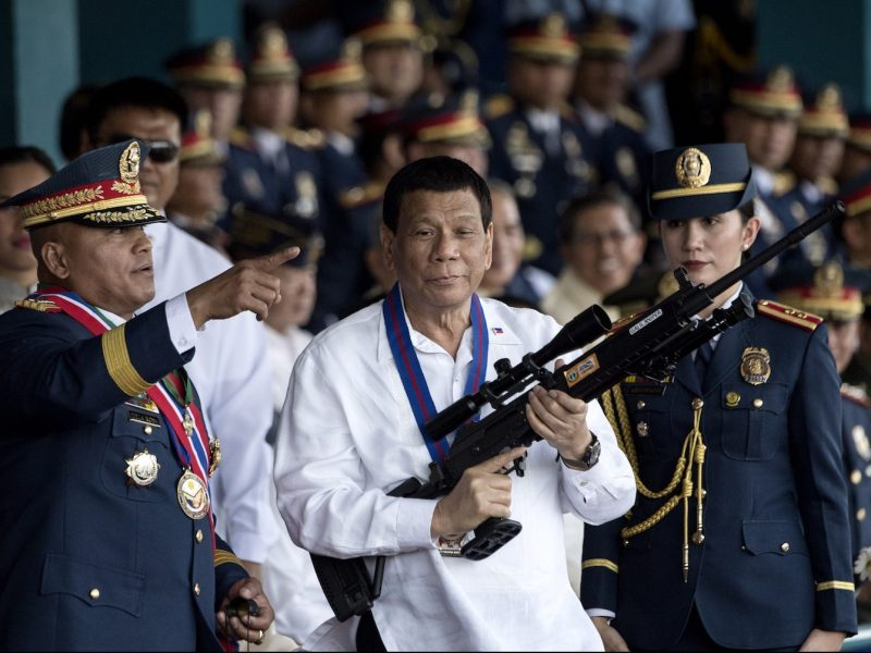 Philippine President Rodrigo Duterte holds a Galil sniper rifle at Camp Crame in Manila on April 19, 2018. Photo: AFP.Noel Celis