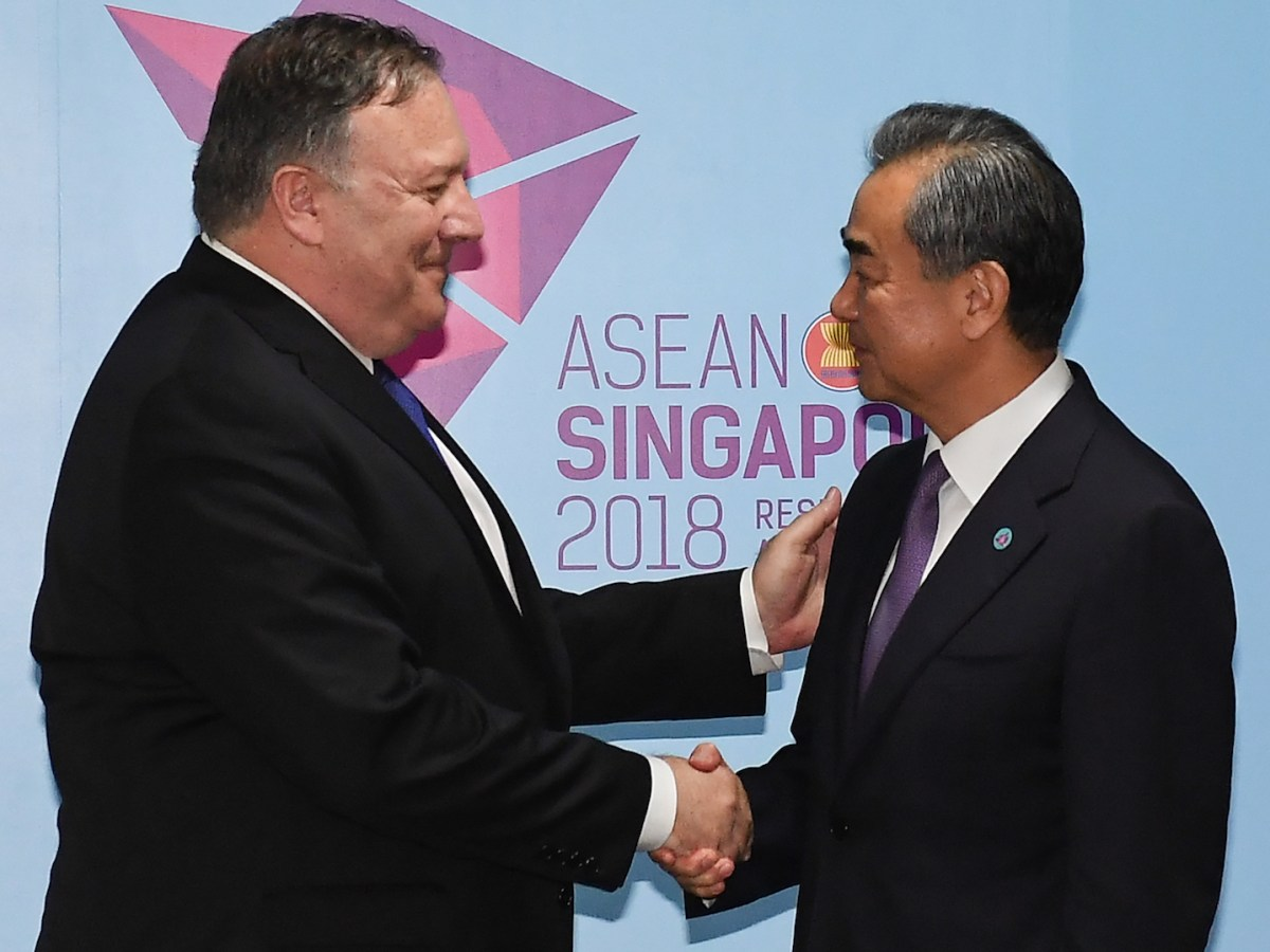 US Secretary of State Mike Pompeo (L) and China's Foreign Minister Wang Yi (R) shake hands before their bilateral meeting at the 51st Association of Southeast Asian Nations (ASEAN) in Singapore on August 3, 2018. Photo: AFP/Mohd Rasfan