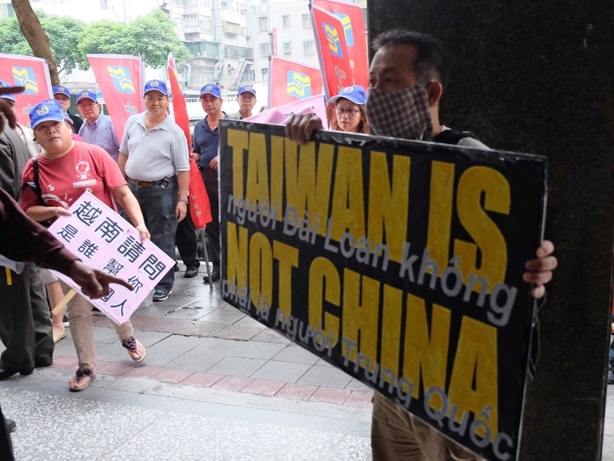 A protestor displays a placard during a demonstration in front of the Vietnam Economic and Cultural offices in Taipei on May 16, 2014 after anti-China protesters set factories on fire in Vietnam in the biggest eruption of rage against Beijing for decades. Photo: AFP/Sam Yeh