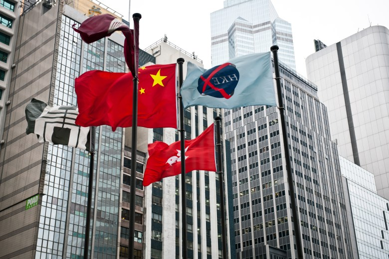 Flags of China, Hong Kong, and Hong Kong Stock  Exchange in front of the Exchange Square. Photo: iStock