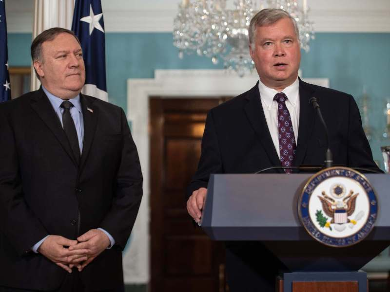 New US special representative to North Korea Steve Biegun speaks after being named by Secretary of State Mike Pompeo, left, at the State Department in Washington DC, on August 23, 2018. A planned return trip by Pompeo was canned by the president shortly after. Photo: AFP / Nichola Kamm