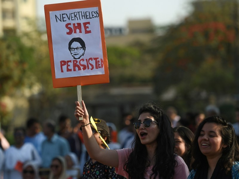 Pakistani civil society activists carry placards as they march during a rally to mark International Women's Day in Karachi on March 8, 2018. Photo: AFP/Asif Hassan