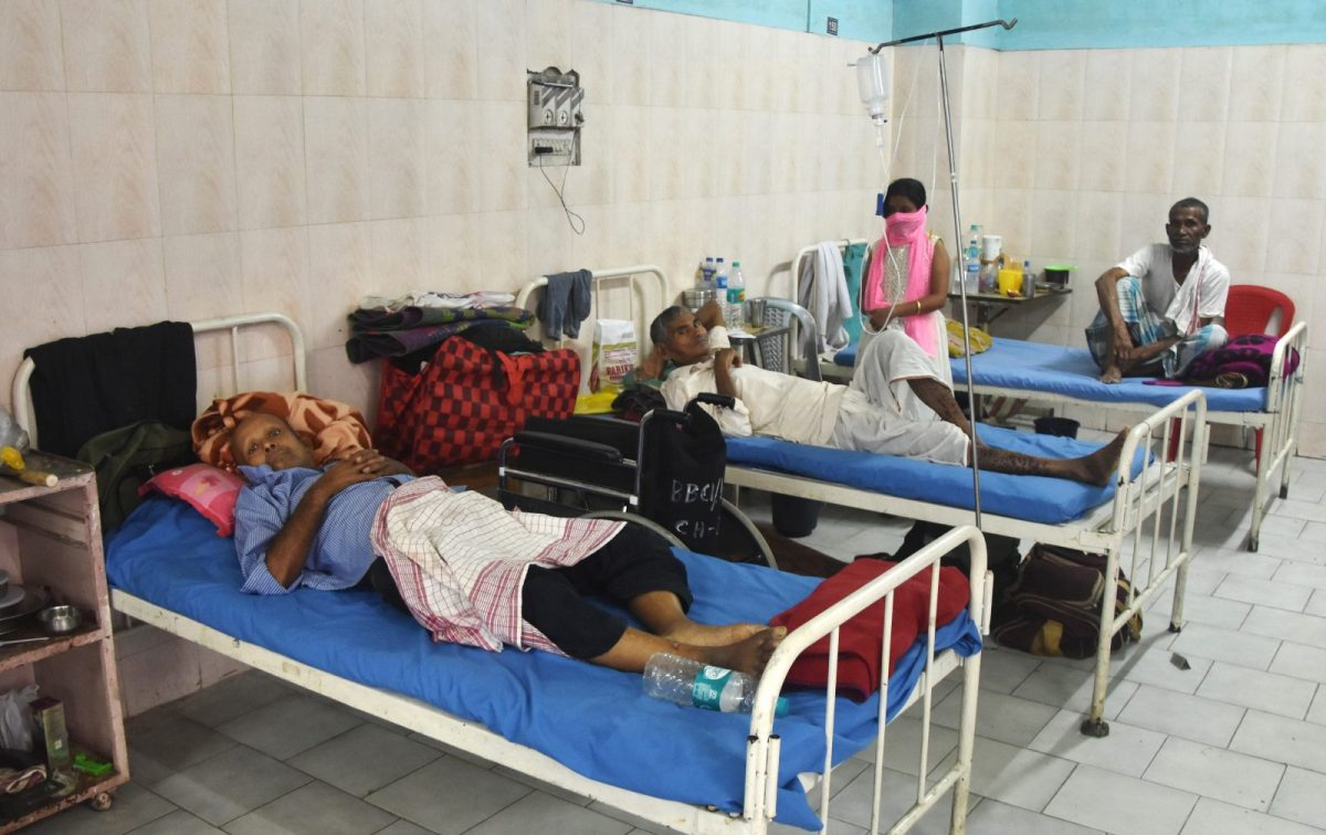 Cancer patients rest on beds at Dr Bhubaneswar Borooah Cancer Institute and research centre in Guwahati in Assam. Photo: AFP
