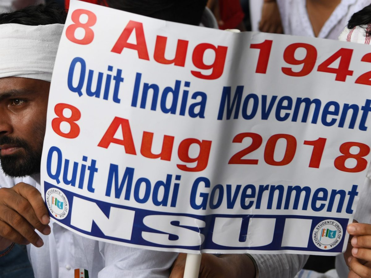 A member of the National Students Union of India, the student wing of India's opposition Congress party, holds a placard during a demonstration against the increase in lawlessness and unemployment in India under the the ruling alliance led by Prime Minister Narendra Modi in New Delhi. Photo: AFP