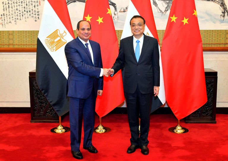 Egyptian President Abdel Fattah al-Sisi poses with Chinese Premier Li Keqiang at the Diaoyutai State Guesthouse in Beijing on Sunday. Photo: AFP