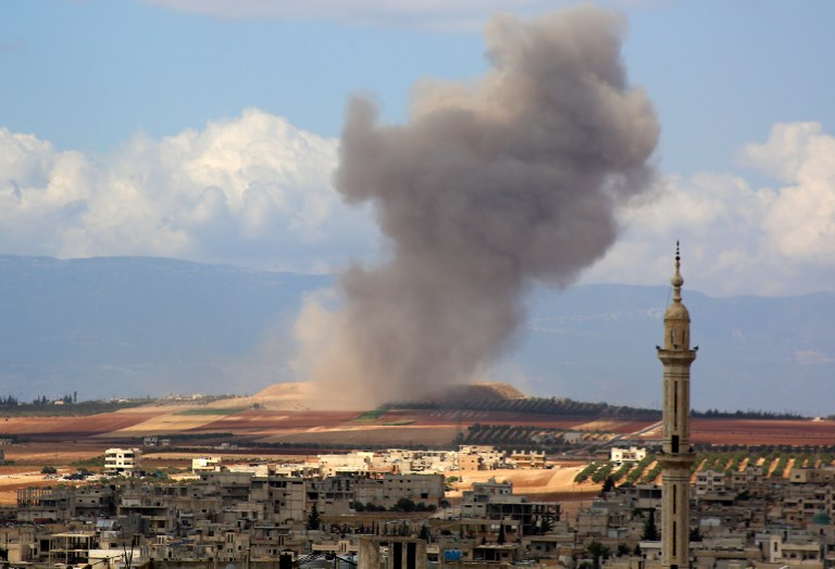 Smoke rises in the Syrian village of Kafr Ain in the southern countryside of Idlib province after an air strike on September 7. Photo: AFP/Anas al-Dyab
