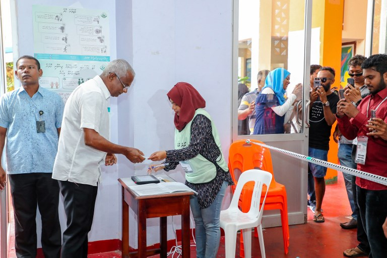 Maldives opposition leader Ibrahim Mohamed Solih votes at a polling station in the capital Male on Sunday. Photo: AFP