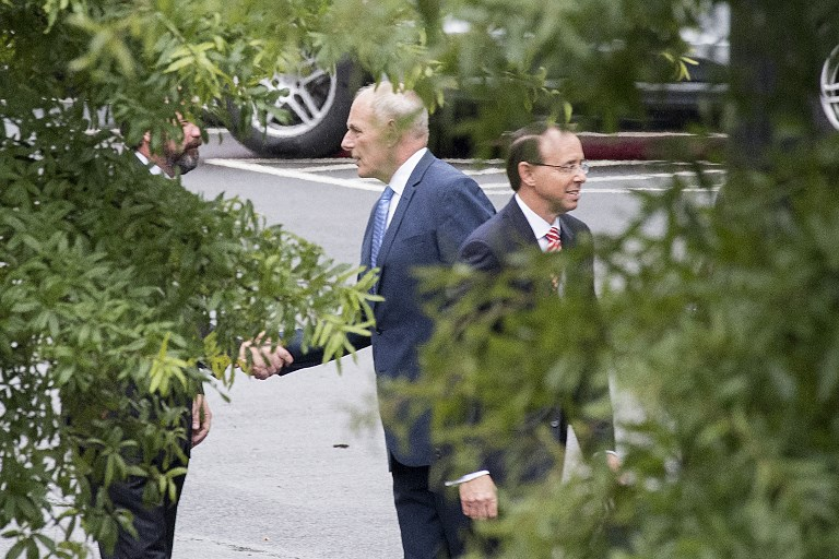 Assistant Attorney General Rod Rosenstein leaves the White House after shaking hands with Chief of Staff John Kelly. Photo: AFP/Jim Watson