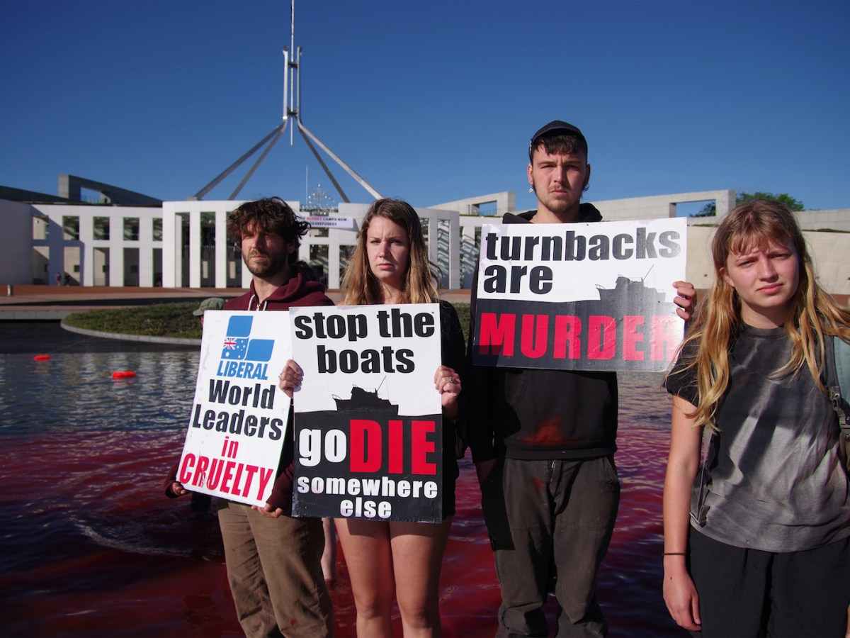 Australian protesters carry placards in front of Parliament in Canberra demanding the closure of offshore detention camps for boat-people. Photo: AFP/Nathanial Howells
