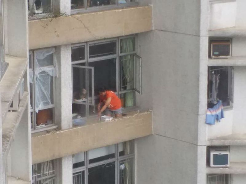 The domestic worker on the ledge at South Horizons on Hong Kong Island. Photo: Facebook