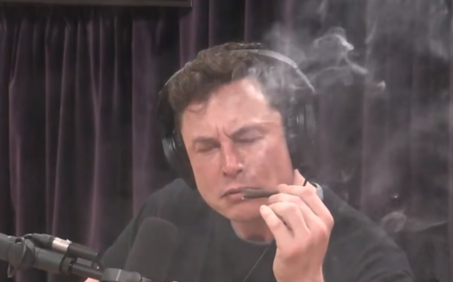 In this screen grab, Elon Musk is pictured smoking what is believed to be marijuana during a recent radio interview. Photo: YouTube