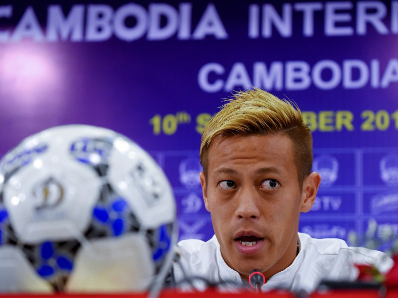 Japanese football star Keisuke Honda speaks during a press conference in Phnom Penh on Sept 9, 2018 on the eve of a friendly match between Cambodia and Malaysia. Photo: AFP / Tang Chhin Sothy
