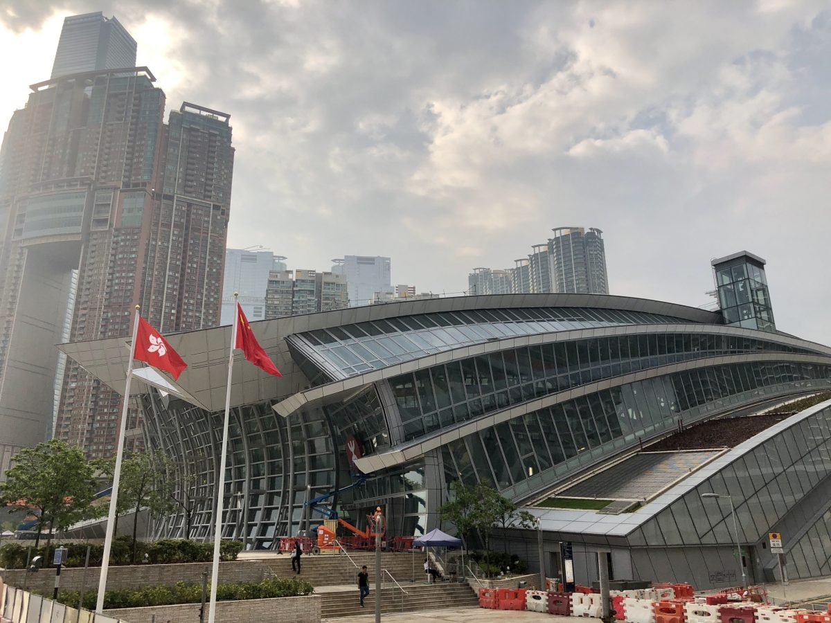 Chinese and Hong Kong flags raised outside the West Kowloon Terminus of Hong Kong's express rail link to mainland China. Photo: Asia Times