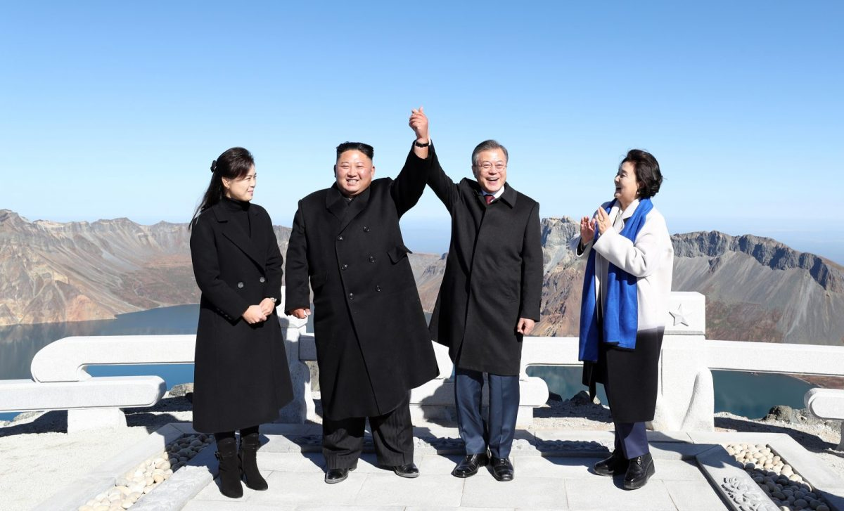 North Korean leader Kim Jong Un and his wife Ri Sol Ju, left, with South Korean President Moon Jae-in and his wife Kim Jung-sook on the top of Mount Paektu on September 20 after their summit. Photo: AFP / Pyeongyang Press Corps