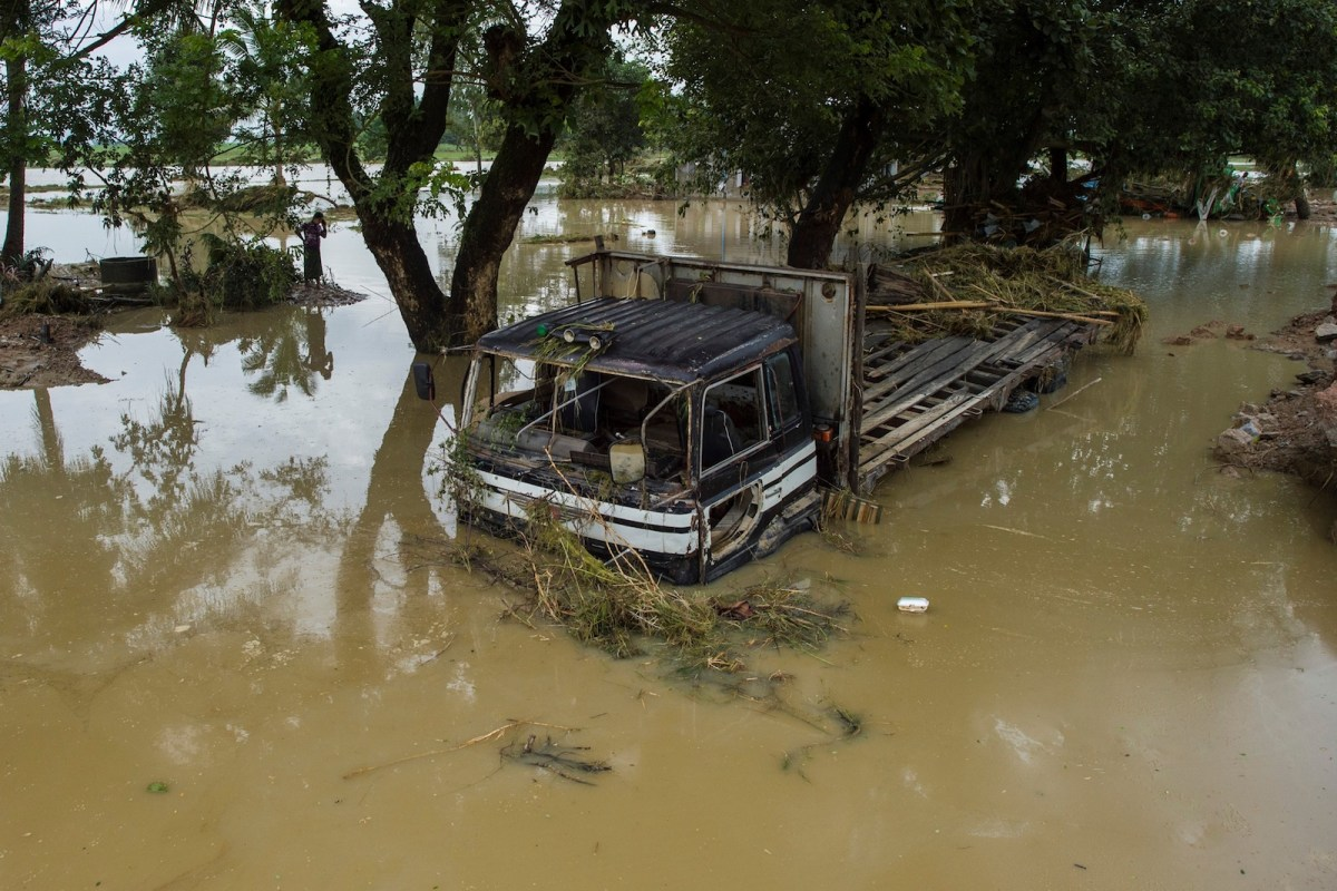 A truck lies submerged by floodwater in Myanmar's Bago region on August 30. Many thousands of people have been stranded after monsoonal rain left the region inundated. Seasonal rain has been getting heavier as weather gets more extreme with global warming, experts say. Photo: AFP / Ye Aung Thu